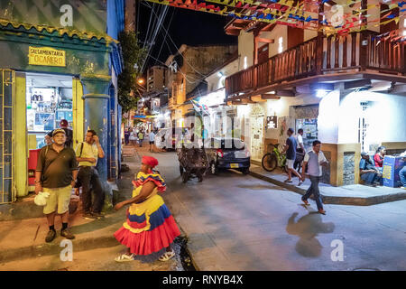 Cartagena Colombia Old Walled City Center centre Getsemani night nightlife Hispanic resident residents pedestrian intersection street corner colonial - Stock Image