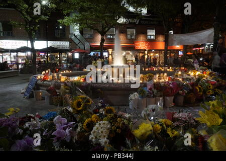 Candel light vigil with flowers and messages in Alexander The Great Parkette on Greek Town Danforth after deadly mass shooting on July 22, 2018 - Stock Image