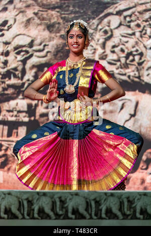 Vertical view of beautiful Bharatanatyam solo dancer performing during Pongal festivities in India. - Stock Image