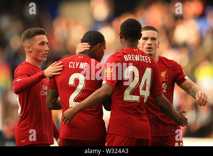 Birkenhead, Wirral, UK. 11th July 2019; Prenton Park, Tranmere, England; Pre-season friendly football, Tranmere versus Liverpool; Nathaniel Clyne of Liverpool is congratulated by team mates Harry Wilson and Rhian Brewster after scoring the opening goal Credit: Action Plus Sports Images/Alamy Live News - Stock Image