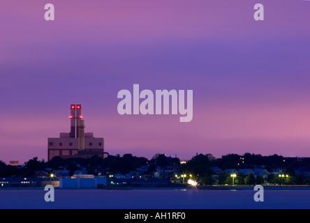 Power plant in South Boston, Massachusetts at sunset - Stock Image