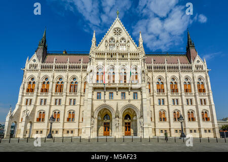 The east front of the Budapest Hungarian Parliament building with a soldier standing guard on a sunny summer day. - Stock Image