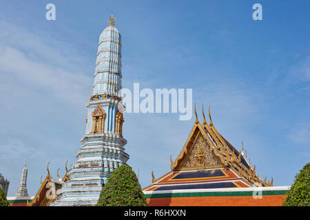 A towering white pagoda inside the Grand Palace in Bangkok, Thailand. - Stock Image