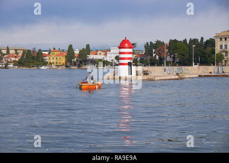 The boatman of Zadar, a family business of ferrying people in a row boat across the harbor. Crossing passenger over - Stock Image