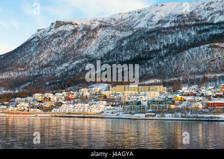 The Reinen district of the city of Tromsø, Norway, seen from a Hurtigruten Coastla Express cruise ship on approach - Stock Image