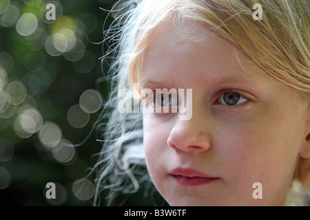 Portrait of blond girl looking away - Stock Image