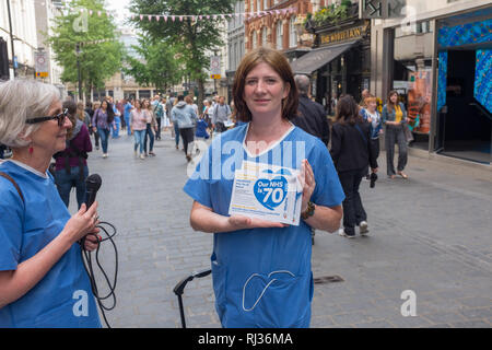 Doctors from the National Health Service (NHS) protest) against plans to privatize services - Stock Image