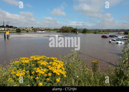 Weymouth Rains Flood the Town Prior to the Weymouth 2012 Olympics with Cars Underwater in Car Park - Stock Image