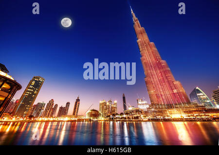 DUBAI, UAE - FEBRUARY 17: Burj Khalifa and fountain - world's tallest tower at 828m at night with moon light - Stock Image