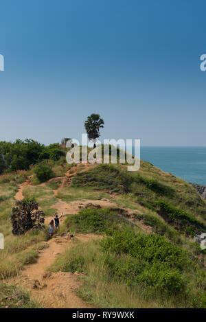 Tourists hiking the trail on Promthep cape, Phuket, Thailand - Stock Image
