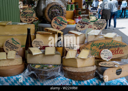 Munich, Bavaria, Germany - May 29, 2019. Stand  at Victuals Market selling all kinds of cheese - Stock Image