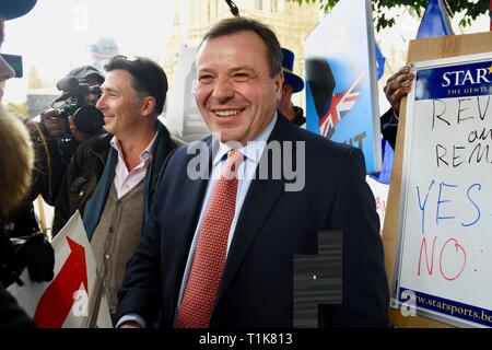 London, UK. 27th Mar, 2019. Arron Banks, Co Founder of Leave EU Campaign, Andy Wigmore, College Green, Houses of Parliament, Westminster, London. UK Credit: michael melia/Alamy Live News - Stock Image