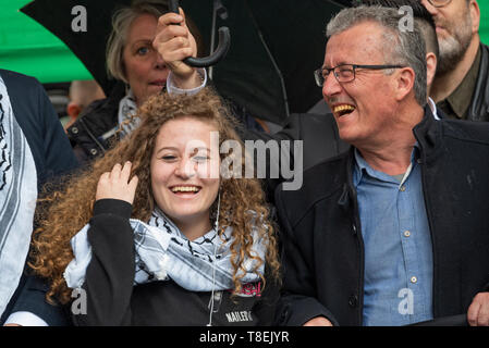 London, UK. May 11th 2019. National Demonstration for Palestine. Thousands of activists marched from Portland Place to Whitehall. Organised by the Palestine Solidarity Campaign, Stop the War Coalition, Palestinian Forum in Britain, Friends of Al- Aqsa & Muslim Association of Britain. Pictured, Palestinian activist Ahed Tamimi (left) joins National Demonstration for Palestine, with father Bassem Tamimi (right). Credit: Stephen Bell/Alamy Stock Photo - Stock Image