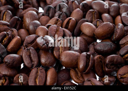 Macro shot of Coffee Beans with focus on center - Stock Image