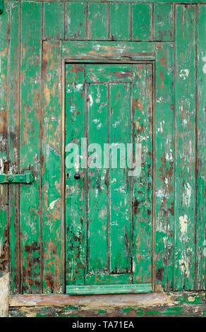 old weathered green painted doorway, norfolk, england - Stock Image