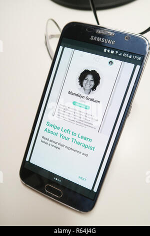 Image of the Talkspace app on a smartphone showing therapist - Stock Image