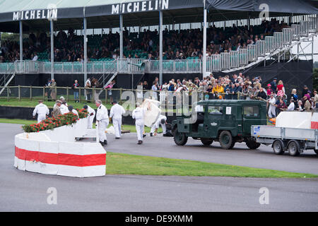 Chichester, West Sussex, UK. 13th Sep, 2013. Goodwood Revival. Goodwood Racing Circuit, West Sussex - Friday 13th September. Marshalls quickly repair a section of the chicane after an accident. © MeonStock/Alamy Live News - Stock Image