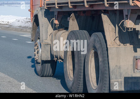 Truck wheels on road in motion - Stock Image