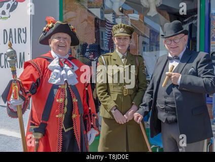 World War 2 reenactors with town cryer - Stock Image