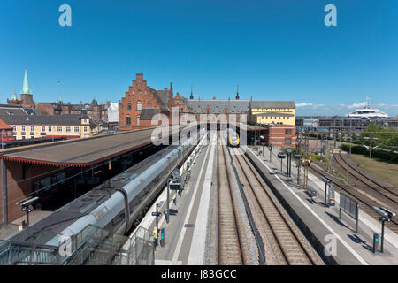 Historic train station in Helsingør, Elsinore, in Neo-Renaissance style from 1891. To the right a Scandlines - Stock Image
