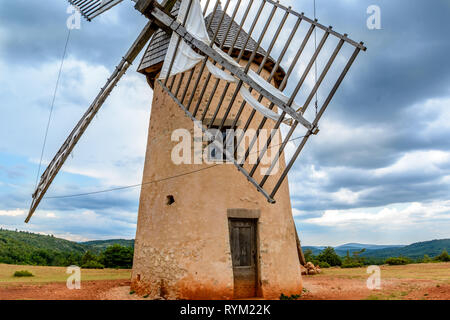 Antique windmill La Couvertoirade a Medieval fortified town in Aveyron, France - Stock Image