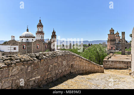View of the Iglesia de San Diego De Alcalá church, left, and the front towers of the Hacienda de Jaral de Berrio from the old Mescal distillery in Jaral de Berrios, Guanajuato, Mexico. The abandoned Jaral de Berrio hacienda was once the largest in Mexico and housed over 6,000 people on the property. - Stock Image