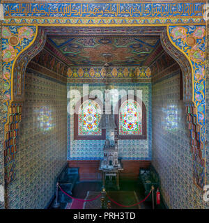 Wooden staircase, Turkish ceramic tiles wall, ornate ceiling and stained glass windows, Residence hall at Manial Palace of Prince Mohammed Ali, Cairo, - Stock Image