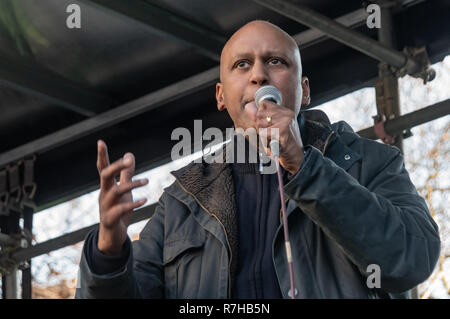 London, UK. 9th Dec, 2018. Shahrar Ali Green Party Home Affairs Spokesperson speaks at the rally by united anti-fascists in opposition to Tommy Robinson's fascist pro-Brexit march. The protest by both remain and leave supporting anti-fascists gathered at the BBC and marched to a rally at Downing St. Police had issued conditions on both events designed to keep the two groups well apart. Credit: Peter Marshall/Alamy Live News - Stock Image