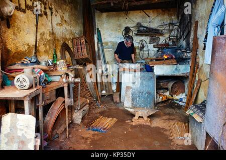A blacksmith in the medina of Meknes, Morocco - Stock Image
