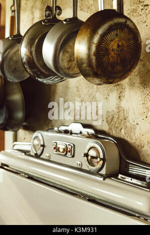 old stove, hanging pans - Stock Image