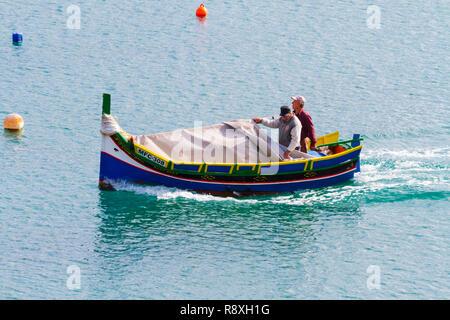 Traditional Maltese luzzo fishing boat, Grand harbour, Valletta, Malta - Stock Image