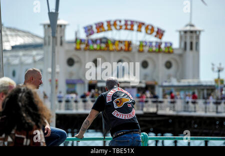 Brighton UK 1st June 2019 - Hundreds of Hells Angels arrive along Brighton seafront as part of their 50th anniversary celebration weekend . Over 3000 bikers from around the world have gathered in Surrey before heading down towards Brighton today where a heavy police presence was keeping an eye on them . Credit : Simon Dack / Alamy Live News - Stock Image
