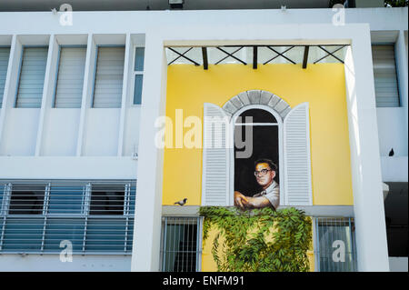 A portrait of the founder looks out from the art and architecture faculty of a university in Thailand. - Stock Image