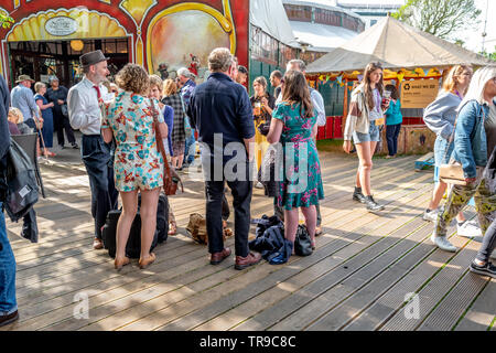People waiting outside the Spiegeltent in Brighton, East Sussex - Stock Image