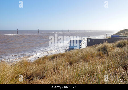 A view of the sea from the sand dunes with volunteer rescue and lifeguard stations on the Norfolk coast at Sea Palling, Norfolk, England, UK, Europe. - Stock Image