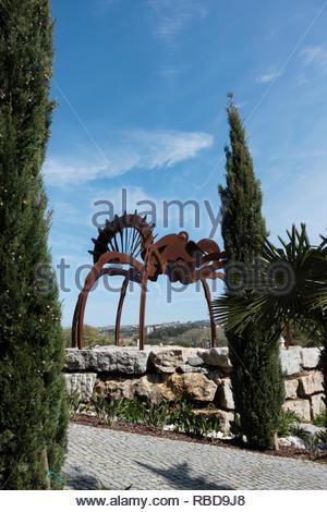 giant metal sculpture of a spider at Buddha Eden Gardens, Bombarrel, Portugal, also called Quinta dos Loridos - Stock Image