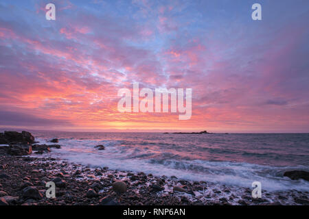 Mousehole, Cornwall, UK. 20th Feb, 2019. UK Weather. Stunning sunrise looking out across the sea at mounts bay from Mousehole this morning. Credit: Simon Maycock/Alamy Live News - Stock Image