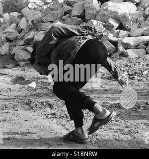Boy playing badminton - Stock Image