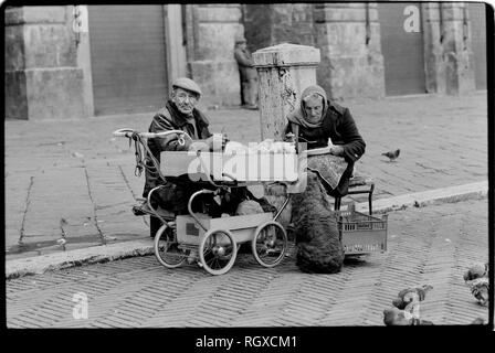 Siena Tuscany Italy. 1990. Elderly couple selling bags of nuts on the Piazza del Campo. - Stock Image