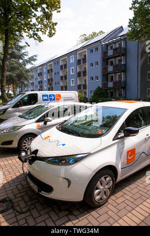 Renault ZOE of the carsharer Cambio at a charging station  at the Stegerwald housing estate in the district Muelheim, climate-protection housing estat - Stock Image