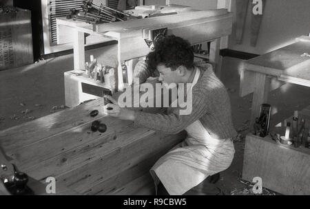 1950s, a  schoolboy in a woodwork or carpentry class, England, UK. - Stock Image