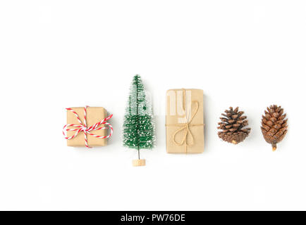 Gift boxes wrapped in craft paper Christmas tree pine cones arranged in row on solid white background. Knolling flat lay. New Year presents holiday pr - Stock Image