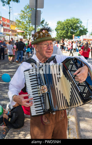 HICKORY, NC, USA-10/14/18:  Closeup of An accordion player roams the crowd and entertains wearing traditional Scandinavian garb. - Stock Image
