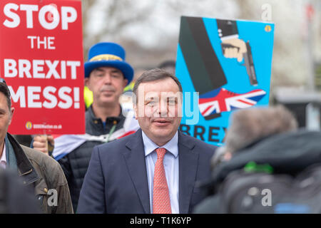 London 27th March 2019,  Arron Banks, Co founder of Leave EU, on College Green being pursued by anti Brexit protesters Credit Ian Davidson/Alamy Live News - Stock Image