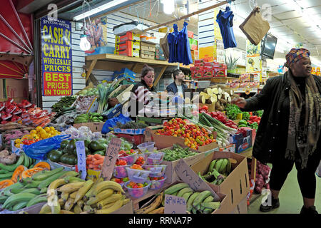 Brixton street market shop selling fruit and vegetables in Electric Avenue Brixton South London SW9 England UK  KATHY DEWITT - Stock Image