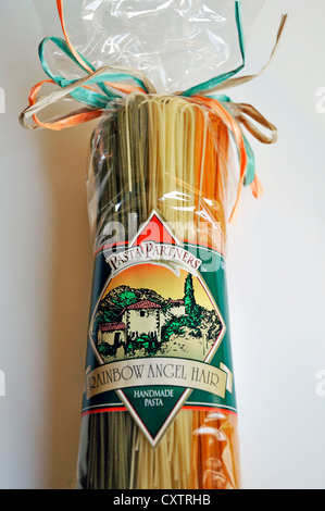 Colored Italian pasta in bag - Stock Image
