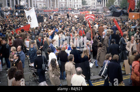 Anti-nuclear Demonstration in London in the 1980's protesting the escalating arms race with banners showing peace signs - Stock Image