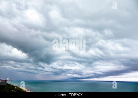 Miami Beach Florida North Beach Atlantic Ocean shoreline storm clouds rain horizon menacing sky - Stock Image