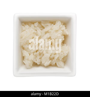 Cooked glutinous rice in a square bowl isolated on white background - Stock Image