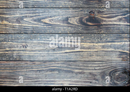 Distressed  wooden texture background / backdrop. Image shot from top in overhead view. - Stock Image